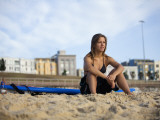 Woman Sitting on Beach with Surfboard at Bondi Beach Photographic Print by Andrew Watson
