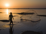 Fisherman Casting Net in the Niger River at Segoukoro Photographic Print by Matthew Schoenfelder
