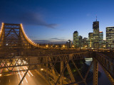Story Bridge and Riverside Business District in Brisbane at Dusk Photographic Print by Andrew Watson
