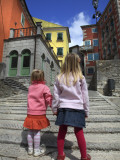 Two Girls on Ulica 1 Maja Street with Colourful Buildings Photographic Print by Ruth Eastham & Max Paoli