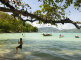 Young Boy on Rope Swing at Tri Trang Beach Photographic Print by Austin Bush