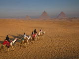 Tourists on Camels and Pyramids of Giza Photographic Print by Richard l'Anson