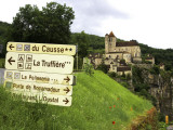 Tourist Signs Outside Village of St. Cirq Lapopie Fotodruck von Barbara Van Zanten