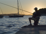 Man Fishing at Sunset at Port Photographic Print by Will Salter