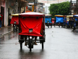 Mototaxis with Protective Rain Covers Photographic Print by Paul Kennedy