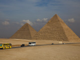 Tour Buses and Cars Driving by Pyramids of Giza Photographic Print by Richard l'Anson