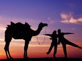 Tourists with Camel Silhouetted at Sunset at Sam Sand Dunes in Great Thar Desert. Photographic Print by Richard l'Anson