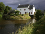 Stormy Sky Behind Lock Keeper's Cottage on Canal De Languitre at Rose Photographic Print by Barbara Van Zanten