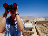 Man with Binoculars at an Archeological Dig Photographic Print by Lou Jones