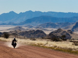 Motorbike Riding Through the Tarisberg Range Fotografiskt tryck av Todd Lawson