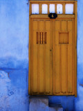 Yellow Doorway in a Blue-Painted House Photographic Print by Tim Hughes