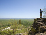 Hiker Looking Out over Kakadu Landscape from Jim Jim Falls Escarpment, on Barrk Marlam Bushwalk Photographic Print by Andrew Watson