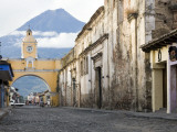 Volcan De Agua Looming Behind Santa Catalina Arch Photographic Print by Sean Caffrey