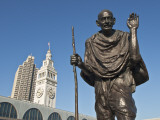 Statue of Mohandas Karamchand Gandhi at Ferry Plaza with Ferry Building Clocktower in Background Photographic Print by Stephen Saks