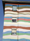 Bold Colours Decorating Facade of Apartment Building Photographic Print by Patrick Syder