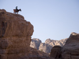 Desert Landscape with Donkey Rider on Ridge-Top Photographic Print by Simon Foale