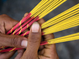 Close-Up of Woman's Hands Holding Incense Sticks Photographic Print by Antony Giblin