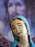 Folk Statue of Our Lady of Guadalupe with Image of Jesus Christ in Background Photographic Print by Ray Laskowitz