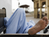 Man Resting on Park Bench in Bur Dubai Photographic Print by Brent Winebrenner