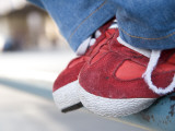 Red Tennis Shoes on Railing Reproduction photographique par Sabrina Dalbesio