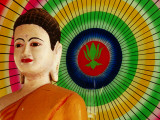 Buddha Statue and Colourful Parasol Photographic Print by Antony Giblin