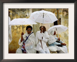 Ethiopian Orthodox Christians during the Holy Thursday Pontifical Mass, Jerusalem, Israel Framed Photographic Print by Oded Balilty