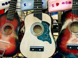 Guitars for Sale at the New Mexico State Fair Photographic Print by Ray Laskowitz