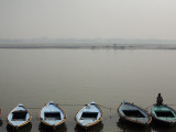 Rowboats Lining Shore of Ganges Photographic Print by April Maciborka