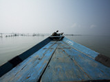 Boat on Lake with Fish Traps Ahead Photographic Print by April Maciborka
