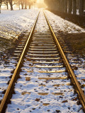 Train Tracks in Snow in Winter Photographic Print by Richard l&#39;Anson