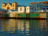 Haulover Creek with Colourful Riverside Buildings in Central Belize City. Photographic Print by Anthony Plummer