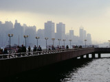 People on the Esplanade, and a View of Hong Kong Island Shrouded in a Twilight Mis Photographic Print by Richard l'Anson