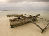 Pwani Mchangani Village on East Coast. Fishing Boat on Beach Fotodruck von Ariadne Van Zandbergen