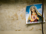 Image of Virgin Mary Hanging in Medical Clinic in Carlos Magno Neighbourhood Photographic Print by Brian Cruickshank