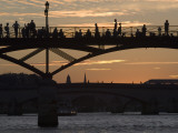 People Silhouetted on Footbridge over River Seine at Sunset Photographic Print by Will Salter