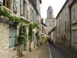 Rue Du Four Bas Leading to Gothic Church St. Maur Photographic Print by Barbara Van Zanten