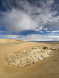 Huge Cumulus Cloud over Eroded and Cracked Clay Formation at Mesquite Flat Sand Dunes Photographic Print by Witold Skrypczak