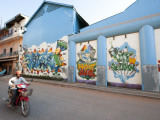 Motorcyclist Passing Night Club with Graffiti Mural Fotografie-Druck von Ariadne Van Zandbergen