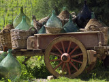 Discarded Wine Demijohns in Cart at Villa a Sesta Photographie par Rocco Fasano