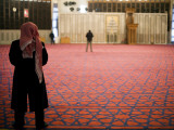 Man Praying Inside King Abdullah Mosque Photographic Print by Brian Cruickshank