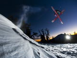 Skier Jumping and Grabbing His Skis at Mout Bachelor Photographic Print by Tyler Roemer