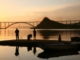 Couple Fishing from Stone Pier with Krk Bridge Joining Krk Island to Mainland Photographic Print by Ruth Eastham & Max Paoli