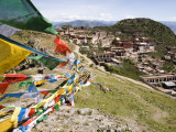 Colourful Prayer Flags at Ganden Monastery Photographic Print by Tim Hughes
