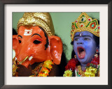 A Child Dressed as Hindu God Krishna Yawns, Chennai, India, September 22, 2006 Framed Photographic Print by M. Lakshman