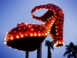 Red Neon Shoe Glowing at Dusk Along Fremont Street Photographic Print by Ray Laskowitz