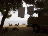 Campers Relaxing by Sea Near Zavala Photographic Print by Will Salter