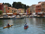 People in Kayaks Approaching Veli Losinj Harbour Photographic Print by Ruth Eastham & Max Paoli