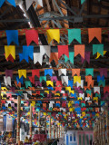 Interior of Ceprama Building with Colourful Flags Celebrating St John's Festivial. Photographic Print by Viviane Ponti