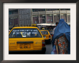 An Afghan Woman Clad in a Burqa Walks Next to a Taxi in Kabul, Afghanistan, Wednesday, June 7, 2006 Framed Photographic Print by Rodrigo Abd