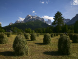 Haystacks in Field with Croda Rossa Dolomite Peaks in Distance Photographic Print by Ruth Eastham & Max Paoli